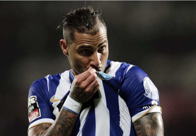 Porto's Quaresma kisses his jersey's emblem during their Portuguese Premier League soccer match against Guimaraes in Guimaraes