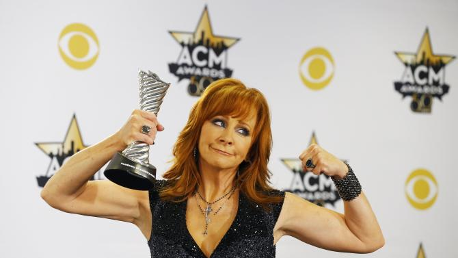 Reba McEntire poses with her award during the 50th Annual Academy of Country Music Awards in Arlington