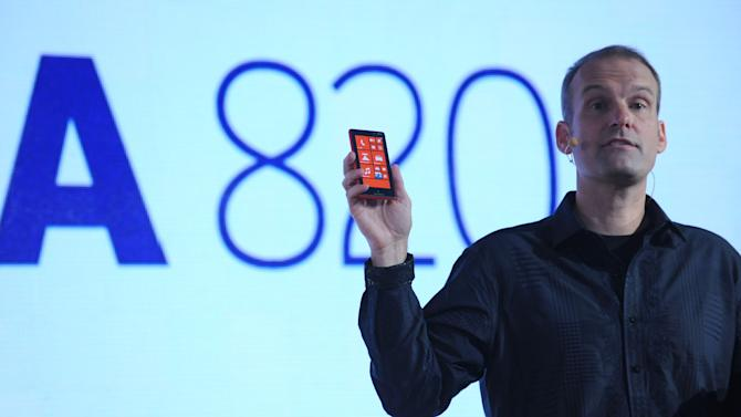 IMAGE DISTRIBUTED FOR NOKIA - Kevin Shields, Nokia senior vice president, holds the Nokia Lumia 820, one of the two Windows Phone 8 smartphones Nokia launched at a press event in New York, Wednesday, Sept. 5, 2012. The Nokia Lumia 820 features exchangeable shells to add color, including red, cyan and purple, as well as wireless charging. (Photo by Diane Bondareff/Invision for Nokia/AP Images)