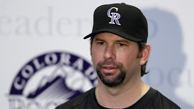 Colorado Rockies' Todd Helton responds to a question during a news conference following a spring training baseball workout, Sunday, Feb. 17, 2013, in Scottsdale, Ariz. (AP Photo/Darron Cummings)