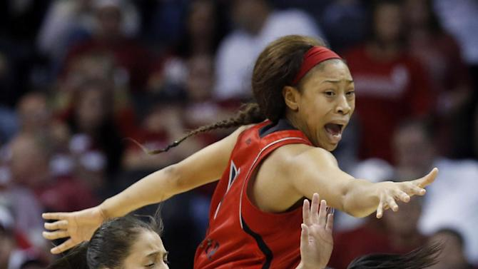 Louisville guard Shoni Schimmel, left, and guard Antonita Slaughter, top, pressure Baylor guard Jordan Madden (3) as she looks for a teammate to pass to in the first half of a regional semifinal game in the women's NCAA college basketball tournament in Oklahoma City, Sunday, March 31, 2013. (AP Photo/Sue Ogrocki)