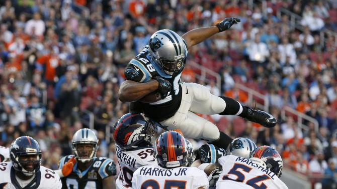 Carolina Panthers' Jonathan Stewart leaps over the goal line to score a touchdown against the Denver Broncos during the NFL's Super Bowl 50 football game in Santa Clara