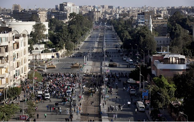 Egyptian army tanks secure the perimeter of the presidential palace while protesters gather chanting anti president Mohammed Morsi slogans, in Cairo, Egypt, Friday, Dec. 7, 2012. Thousands of Egyptian