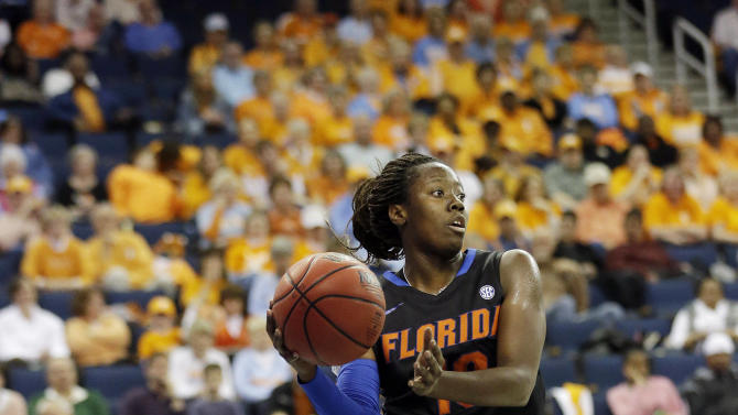 Florida guard Jaterra Bonds (10) keeps the ball inbounds during the first half of an NCAA college basketball game against the Tennessee in the Southeastern Conference tournament, Friday, March 8, 2013, in Duluth, Ga. (AP Photo/John Bazemore)