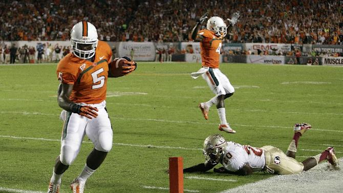 Miami running back Mike James (5) scores a touchdown as he gets past Florida State defensive back Lamarcus Joyner (20) during the first half of an NCAA college football game, Saturday, Oct. 20, 2012, in Miami. (AP Photo/Lynne Sladky)
