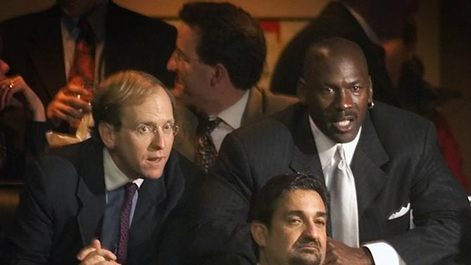 "In this Jan. 19, 2000, file photo, former Chicago Bulls great Michael Jordan, rear right, sits in the owner's sky box with Washington Capitals minority owner Jon Ledecky, left, and Washington Wizards minority owner Ted Leonsis, front, during an NBA game at the MCI Center in Washington. The Islanders have announced that the team is being sold to a former Washington Capitals co-owner and a London-based investor. In a statement Tuesday, Aug. 19, 2014, the team says a group led by former Capitals co-owner Jon Ledecky and investor Scott Malkin has reached an agreement to buy a ""substantial"" minority interest in the team"