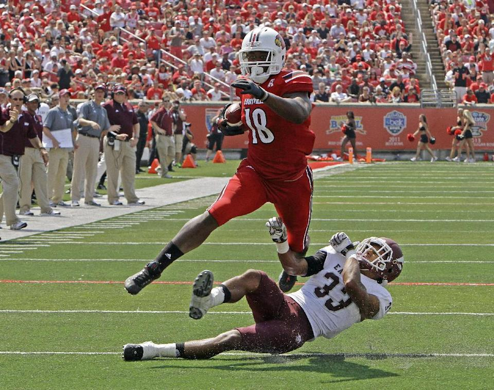 No. 8 Louisville routs E Kentucky 44-7