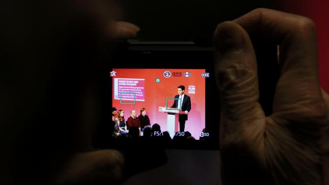 A supporter photographs Britain's opposition Labour Party leader Ed Miliband as he speaks at an election campaign event in Stockton-on -Tees in northern England