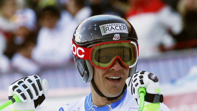 Steve Nyman, of the United States, celebrates in the finish area after winning an alpine ski, men's World Cup downhill in Val Gardena, Italy, Friday, Dec. 19, 2014. (AP Photo/Armando Trovati)
