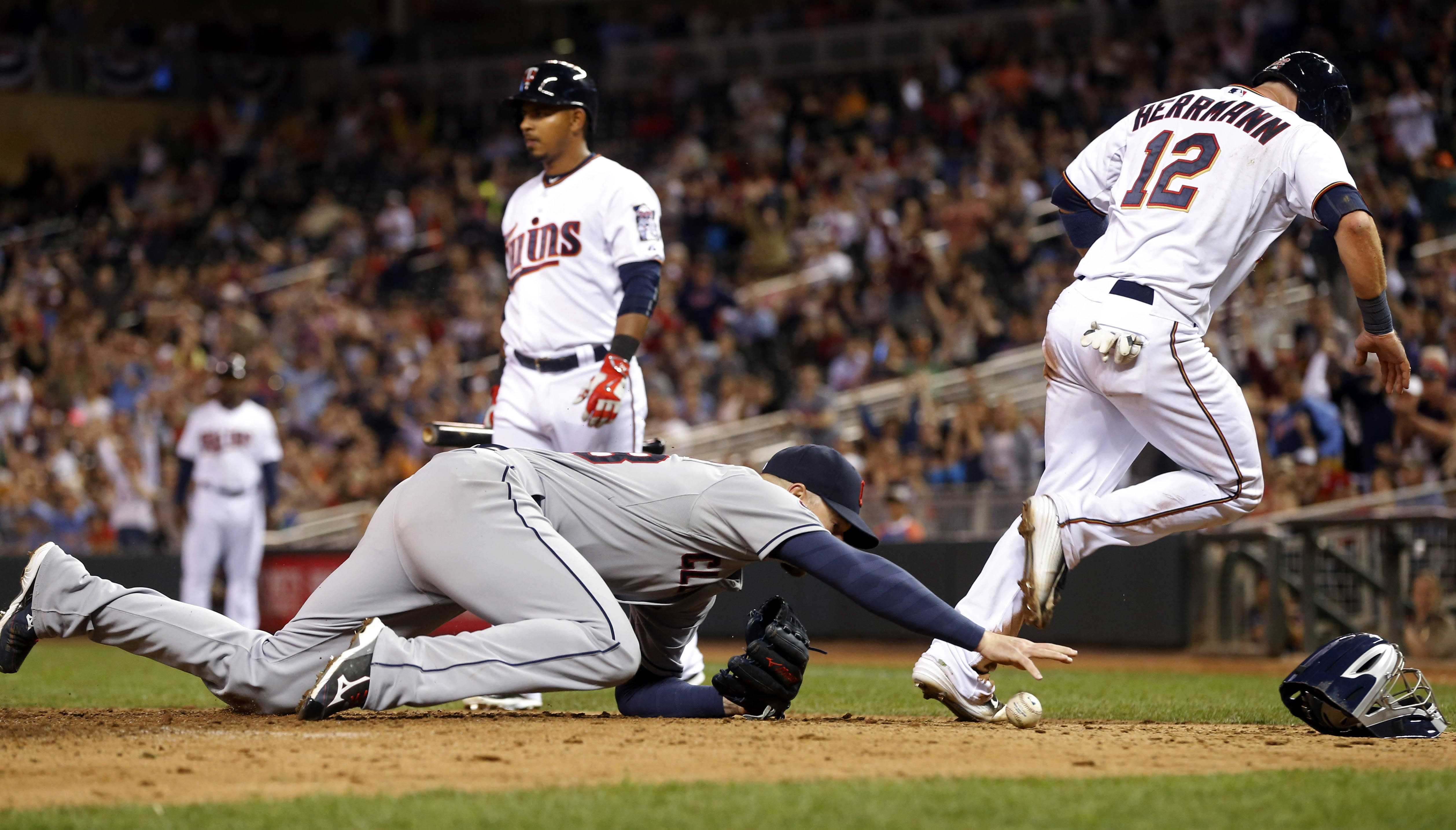 Plouffe's homer in 11th lifts Twins over Indians 3-2