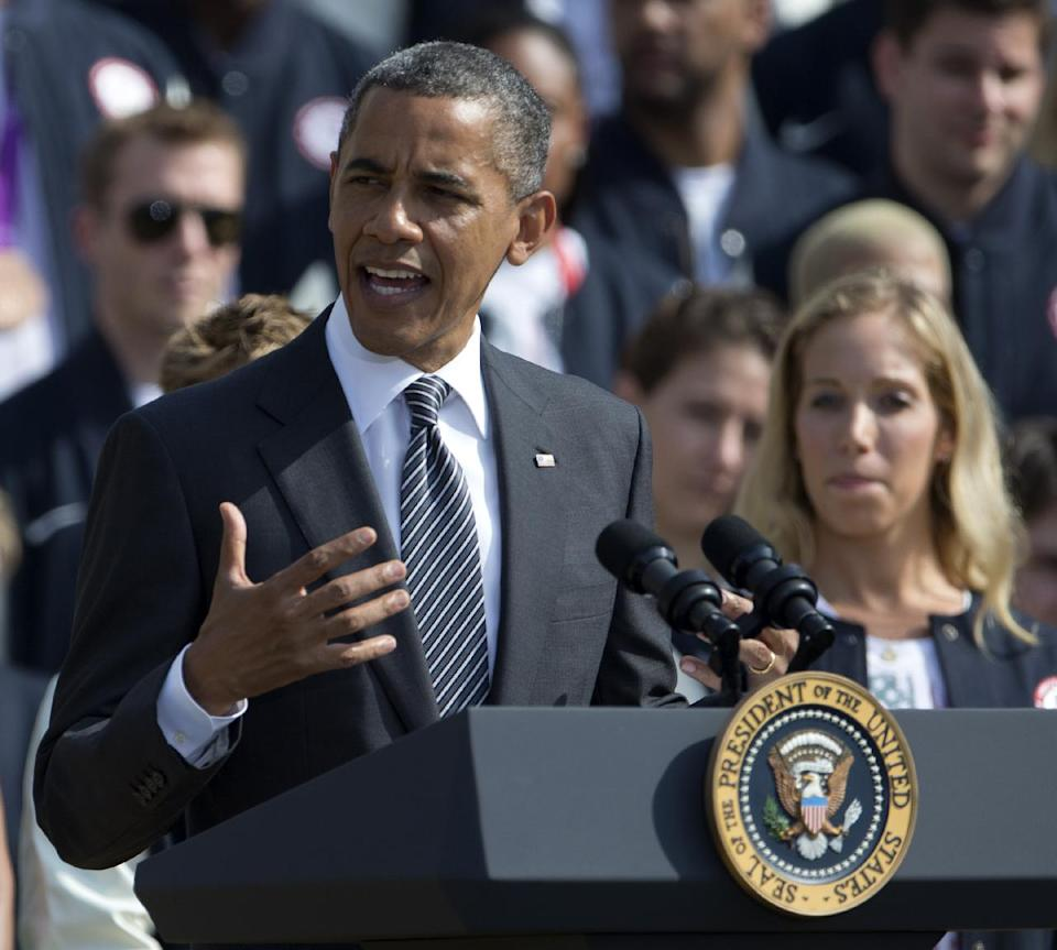 President Barack Obama speaks on the South Lawn of the White House in Washington, Friday, Sept. 14, 2012, during a ceremony to welcome the 2012 U.S. Olympic and Paralympic teams. (AP Photo/Carolyn Kaster)
