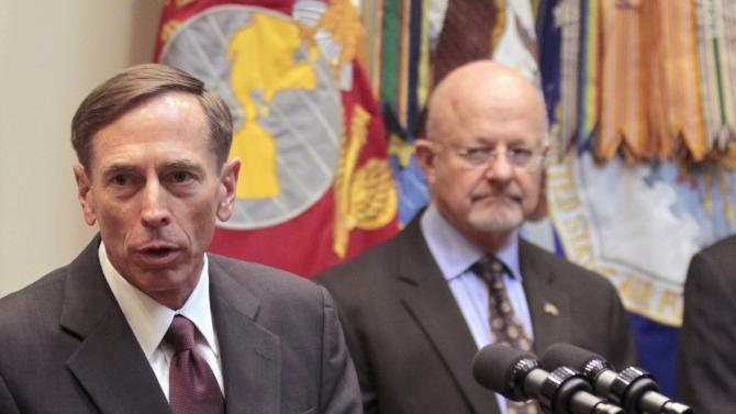 FILE - In this Sept. 6, 2011 file photo CIA Director David Petraeus, accompanied by Director of National Intelligence James Clapper, speaks in the Roosevelt Room of the White House in Washington. The CIA said Tuesday it is investigating whether the agency broke the law by helping the New York Police Department build intelligence-gathering programs that monitored life in Muslim communities. (AP Photo/Pablo Martinez Monsivais, File)