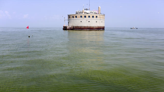 FILE - In this Aug. 3, 2014, file photo, the City of Toledo water intake crib is surrounded by algae in Lake Erie, about 2.5 miles off the shore of Curtice, Ohio. Toledo has detected the first signs in Lake Erie of the dangerous toxin that resulted in a water crisis last year that left 400,000 people in northwestern Ohio and southeastern Michigan without safe tap water for two days announced Monday, July 27, 2015. (AP Photo/Haraz N. Ghanbari, File)