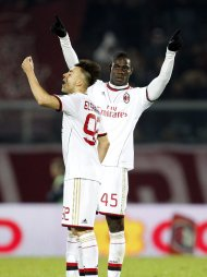 AC Milan's Mario Balotelli (R) celebrates next his teammate Stephan El Shaarawy after scoring his second goal against Livorno during their Italian Serie A soccer match at the Armando Picchi stadium in Livorno December 7, 2013. REUTERS/Giampiero Sposito (ITALY - Tags: SPORT SOCCER)