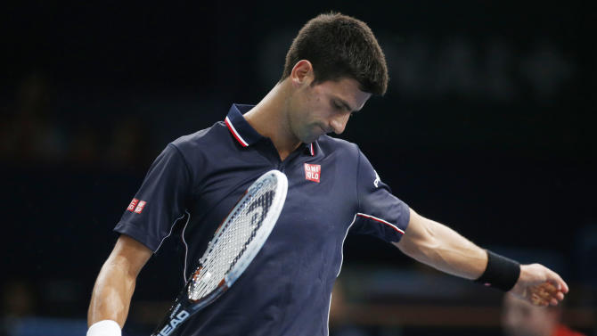 Novak Djokovic of Serbia, reacts after losing a point against Andy Murray of Britain during their quarterfinal match at the ATP World Tour Masters tennis tournament at Bercy stadium in Paris, France, Friday, Oct. 31, 2014. (AP Photo/Michel Euler)