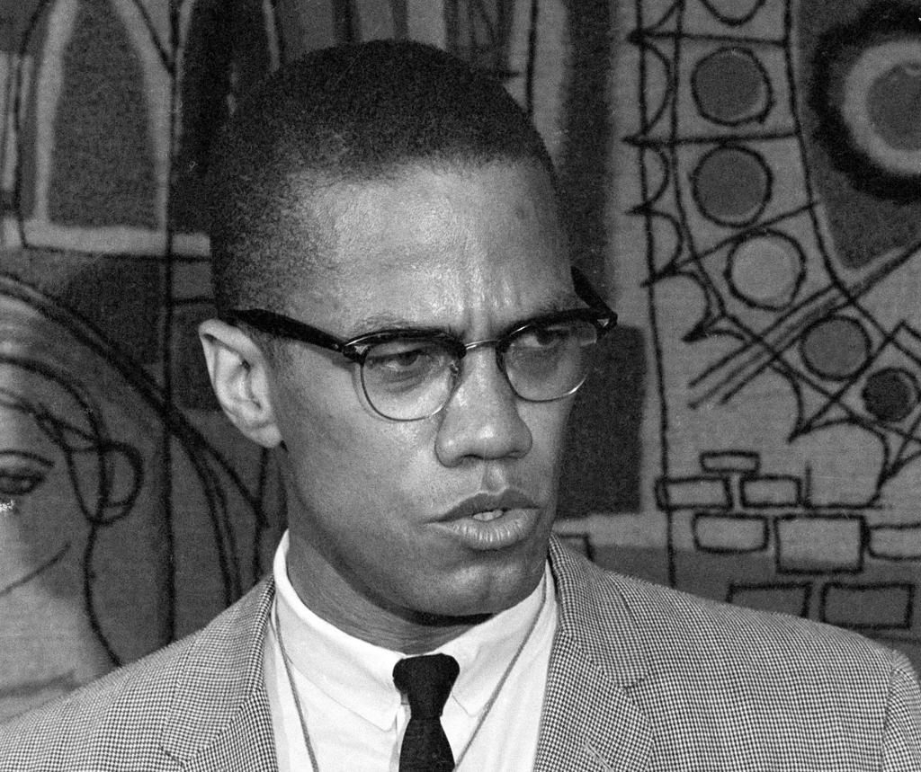 "FILE - This March 12, 1964 file photo, Malcolm X addresses reporters at the Hotel Park-Sheraton in New York. Malcolm X's family and estate said rapper-singer Nicki Minaj's use of the black nationalist with a rifle in his hands, juxtaposed with a racial slur, for her single artwork is disrespectful and offensive. In an exclusive statement to The Associated Press on Friday, Feb. 14, 2014, Malcolm X's daughter, Ilyasah Shabazz, said Minaj's use of the picture is ""in no way is endorsed by my family."" (AP Photo, File)"