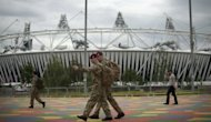 "British soldiers walk past the Olympic Stadium in Stratford, east London. The head of private security giant G4S has agreed under questioning by British lawmakers that the firm's failure to provide enough security guards for the Olympics was ""a humiliating shambles"""
