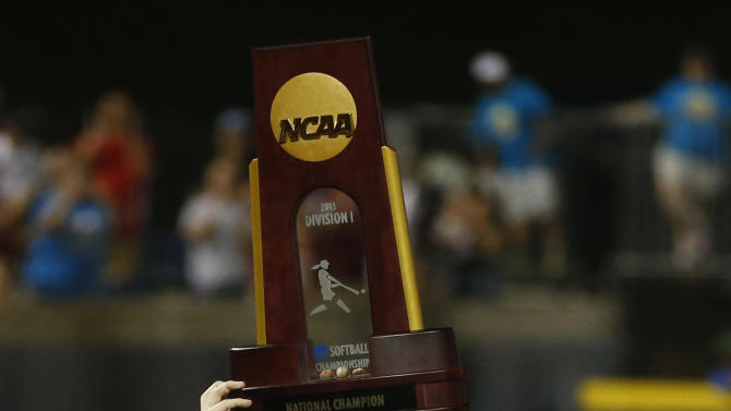 CORRECTS SCORE TO 4-0-Oklahoma's Keilani Ricketts holds the championship trophy after Oklahoma defeated Tennessee in the second game of the best of three Women's College World Series NCAA softball championship series in Oklahoma City, Tuesday, June 4, 2013. Oklahoma won the game 4-0 and the best of three series in two games.(AP Photo/Sue Ogrocki)