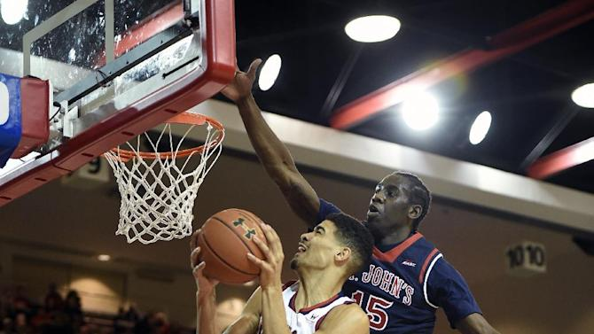 St. Mary's guard Treaven Duffy (25) is fouled by St. John's guard Sir'Dominic Pointer (15) during the first half of an NCAA college basketball game on Friday, Dec. 19, 2014, in New York. (AP Photo/Kathy Kmonicek)