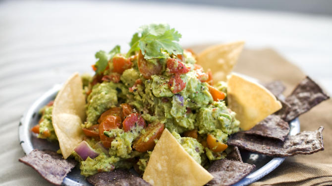 In this image taken on January 7, 2013, a recipe for roasted fresh salsa guacamole is shown in Concord, N.H. (AP Photo/Matthew Mead)