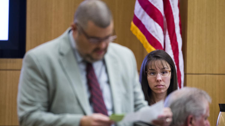 Defense attorney Kirk Nurmi, left, asks Jodi Arias a question during her murder trial, Thursday, March 7, 2013 in Maricopa County Superior Court in Phoenix. Arias is on trial for the 2008 murder of Travis Alexander. (AP Photo/The Arizona Republic, Tom Tingle, Pool)