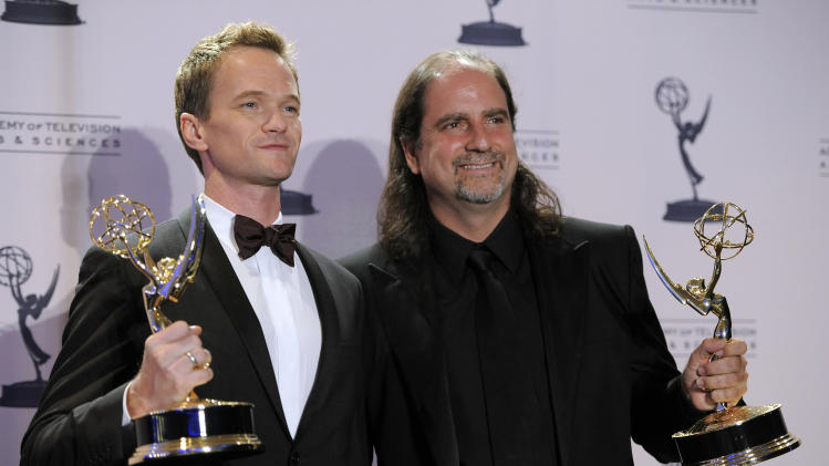 Neil Patrick Harris, left, and Glenn Weiss pose backstage with their awards for outstanding special class programs for the 65th Annual Tony Awards at the 2012 Creative Arts Emmys at the Nokia Theatre on Saturday, Sept. 15, 2012, in Los Angeles. (Photo by Chris Pizzello/Invision/AP)