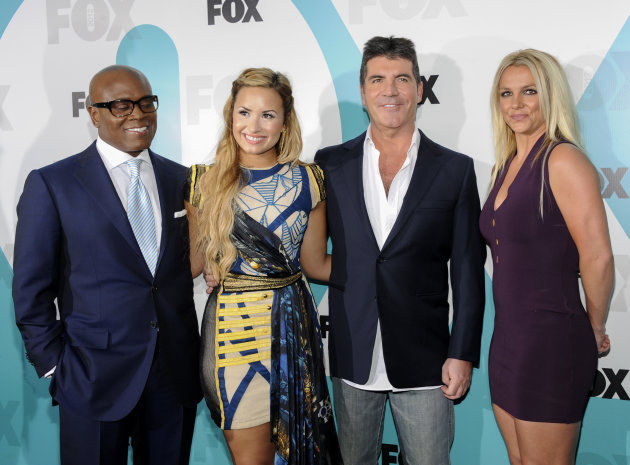 """The X Factor"" judges, from left, L.A. Reid, Demi Lovato, Simon Cowell and Britney Spears attend the FOX network upfront presentation party at Wollman Rink, Monday, May 14, 2012 in New York. (AP Photo"