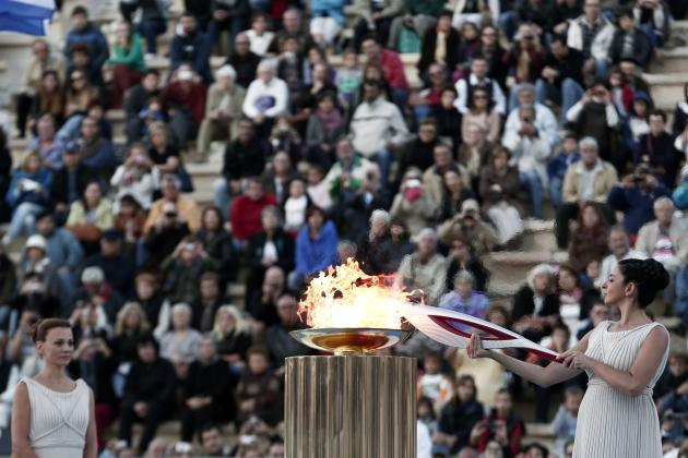 Greek actress Menegaki lights an Olympic torch of the Sochi 2014 Winter Games during a handover ceremony at the Panathenean stadium in Athens