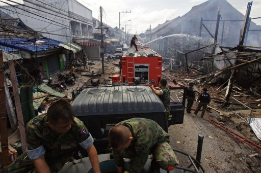 <p>Thai members of the security forces gather at the site of a car bomb attack at a packed market in Sai Buri. At least six people were killed and more than 40 were wounded after a car bomb exploded in a busy shopping street in Thailand's insurgency-hit south, officials told AFP.</p>