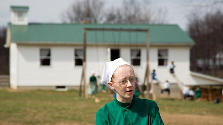 Emma Miller answers questions during an interview in Bergholz, Ohio on Tuesday, April 9, 2013.  Miller was convicted and sentenced to prions for her role in the hair and beard cutting scandal against other Amish members.  (AP Photo/Scott R. Galvin)