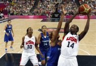 Tina Charles (14) of the United States shoots over France's Sandrine Gruda (7) during their women's gold medal basketball game at the 2012 Summer Olympics on Saturday, Aug. 11, 2012, in London. (AP Photo/Sergio Perez, Pool)