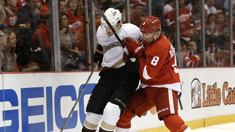Anaheim Ducks defenseman Luca Sbisa (5), of Italy, protects the puck from Detroit Red Wings left wing Justin Abdelkader (8) in the second period in Game 6 of a first-round NHL hockey Stanley Cup playoff series in Detroit, Friday, May 10, 2013. (AP Photo/Paul Sancya)