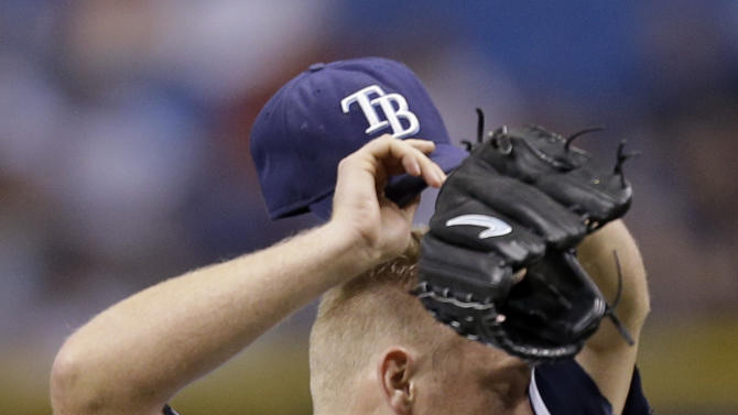 Tampa Bay Rays starting pitcher Alex Cobb reacts as he gives up six runs to the Boston Red Sox during the first ininng of a baseball game Monday, June 10, 2013, in St. Petersburg, Fla. (AP Photo/Chris O'Meara)