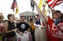 Protesters against President Barack Obama&#39;s 2010 healthcare overhaul react in Washington