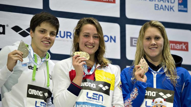 Gold medallist Belmonte Garcia of Spain poses with silver medallist Hentke of Germany and bronze medallist Lowe of Britain during the 200m women's butterfly victory ceremony of the 2013 European Short Course Swimming Championships in Herning