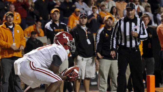 Alabama wide receiver Amari Cooper (9) catches a pass for a touchdown during the first quarter of an NCAA college football game against Tennessee, Saturday, Oct. 20, 2012 in Knoxville, Tenn. (AP Photo/Wade Payne)