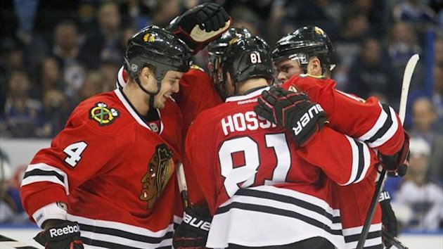 Chicago Blackhawks team-mates celebrate a goal by Marian Hossa (Reuters)