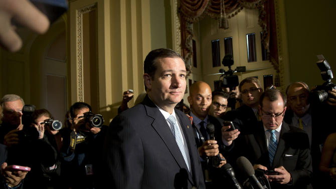 FILE - In this Oct. 16, 2013 file photo, Sen. Ted Cruz, R-Texas, speaks with reporters on Capitol Hill in Washington and said Republicans lost the government shutdown budget battle because some members of his own party in Congress turned on their colleagues. The bigger worry for many GOP party leaders is the growing rift between business-oriented Republicans and the GOP's more ideological wing. Each accuses the other of bungling the debt ceiling and government shutdown dramas, widely seen as a major Republican embarrassment. (AP Photo/Carolyn Kaster, File)