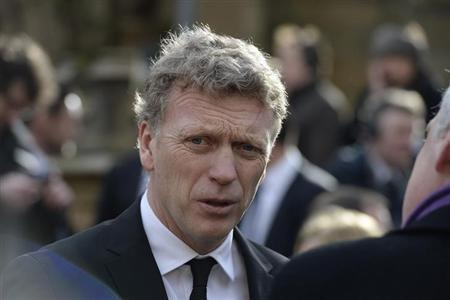 Manchester United's manager David Moyes arrives for the funeral of former Preston and England soccer player Tom Finney at Preston Minster, northern England February 27, 2014. REUTERS/Nigel Roddis/