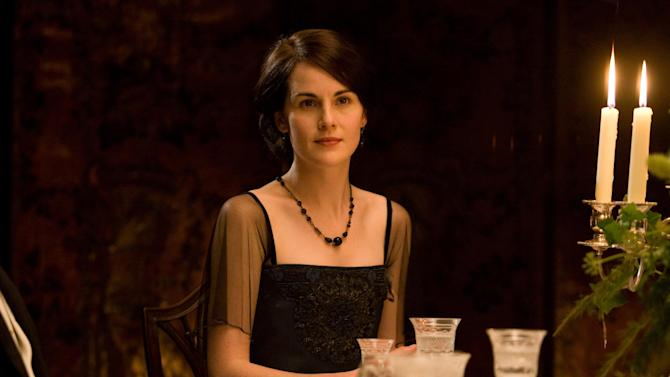 "In this image released by PBS, Michelle Dockery portrays Lady Mary in a scene from the second season of ""Downton Abbey."" Dockery was nominated Thursday, Dec. 13, 2012 for a Golden Globe for best actress in a drama series for her role in the show.  The 70th annual Golden Globe Awards will be held on Jan. 13. (AP Photo/PBS, Carnival Film & Television Limited 2011 for MASTERPIECE)"