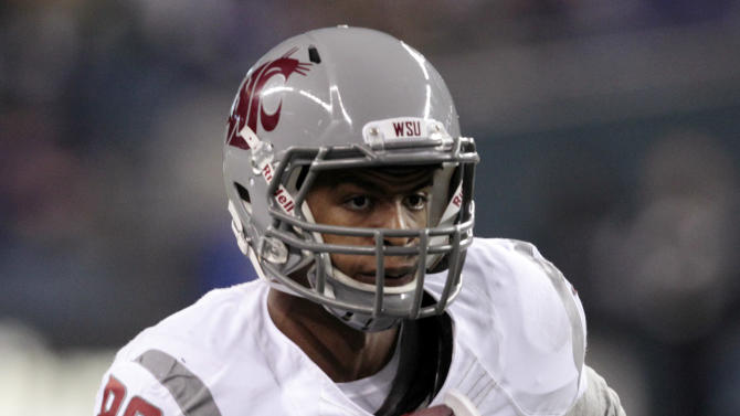 """FILE - This Nov. 26, 2011 file photo shows Washington State's Marquess Wilson returning a reception for a 38-yard touchdown during the second half of an NCAA college football game against Washington, in Seattle. The star receiver's allegations that he has been physically and emotionally abused by coaches have roiled Washington State, and the school president has called for an investigation of Marquess Wilson's complaints against new coach Mike Leach and his staff. Wilson on Saturday, Nov. 10, 2012,  quit the team, saying coaches """"preferred to belittle, intimidate and humiliate us."""" (AP Photo/Elaine Thompson, File)"""