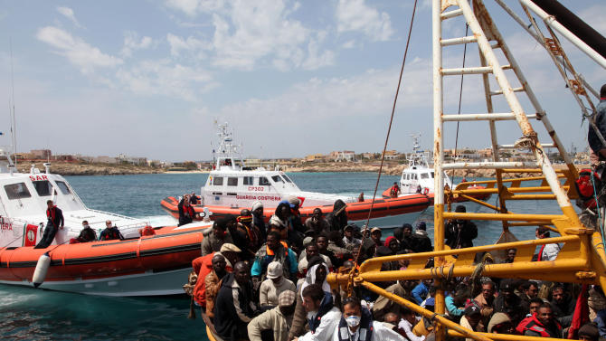 FILE -- In this April 19, 2011 file photo provided by the Italian Coastguard, a boat reportedly carrying 760 migrants arrives at the Lampedusa harbor, Italy. Italy is officially ending its Mare Nostrum rescue operations Friday Nov. 1 2014, and the EU's Frontex border control will begin its Tritone mission Saturday. Italy launched the Mare Nostrum operation last year after 366 would-be migrants drowned off Sicily. Ships and aircraft involved in the 9.5 million-euro ($11.9 million) per month mission patrolled close to the Libyan coast, rescuing over 100,000 people. Interior Minister Angelino Alfano said Italy will still honor its obligation to respond to ships in distress and that no lives will be sacrificed. (AP Photo/Italian Coastguard, h.o. FILE)