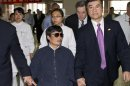 FILE - In this file photo taken Wednesday, May 2, 2012. and released by the U.S. Embassy Beijing Press Office, blind activist Chen Guangcheng, center, holds hands with U.S. Ambassador to China, Gary Locke, at a hospital in Beijing. Chen told The Associated Press Saturday, May 10, 2012 that he is now at the Beijing airport on his way to the United States after leaving hospital. (AP Photo/U.S. Embassy Beijing Press Office, File)