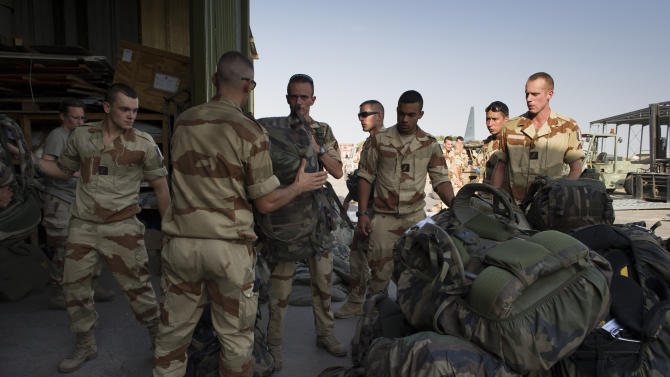 This picture released by the French Army Communications Audiovisual office (ECPAD) shows French soldiers of the 21st Marine Infantry Regiment preparing to board for Bamako, the capital from Mali, at the N'Djamena's airport, in Chad, Friday, Jan. 11, 2013. The battle to retake Mali's north from the al-Qaida-linked groups controlling it began in earnest Saturday, after hundreds of French forces deployed to the country and began aerial bombardments to drive back the Islamic extremists from a town seized earlier this week. (AP Photo/ R.Nicolas-Nelson, Ecpad)