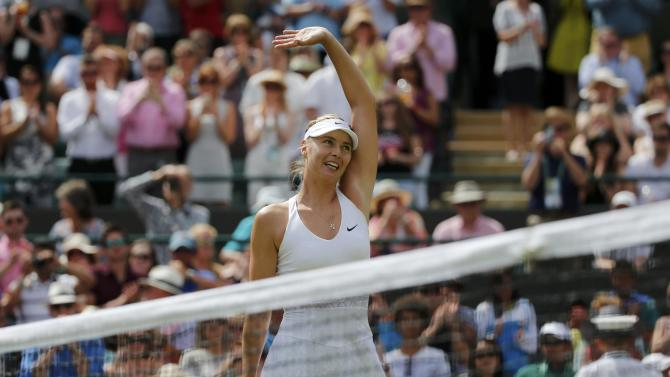 Maria Sharapova of Russia celebrates after winning her match against Zarina Diyas of Kazakhstan at the Wimbledon Tennis Championships in London