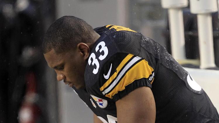 Pittsburgh Steelers running back Isaac Redman (33) sits on the bench as his team is losing to the San Diego Chargers in the fourth quarter of an NFL football game in Pittsburgh, Sunday, Dec. 9, 2012. The Chargers won 34-24. (AP Photo/Gene J. Puskar)