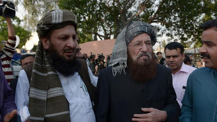 Pakistani members of the negotiating committee from the Tehreek-e-Taliban Pakistan (TTP) Maulana Sami ul Haq (2nd left) and Mualana Yousaf Shah (left) speak to the media after a meeting of the negotiation committee in Islamabad, on March 22, 2014