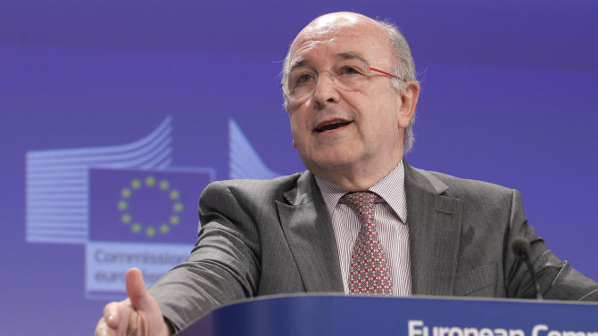 European Commissioner for Competition Joaquin Almunia addresses the media, at the European Commission headquarters in Brussels, Wednesday, Dec. 18 2013. The European Union on Wednesday opened legal proceedings into whether Real Madrid, Barcelona and five other Spanish clubs get an unfair edge from illegal state aid. (AP Photo/Yves Logghe)