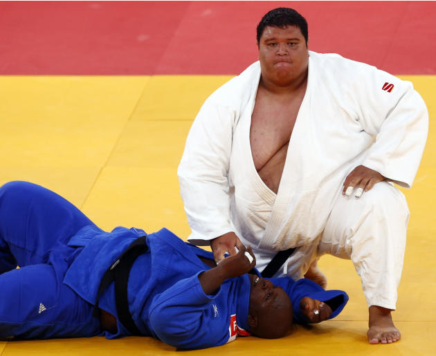 Guam's Ricardo Blas Jr. looks up after winning his men's  100kg elimination round of 32 judo match against Guinea's Facinet Keita at the London 2012 Olympic Games