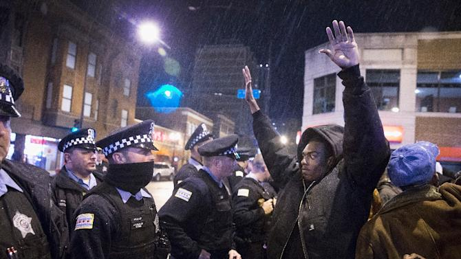Demonstrators confront police during a protest over the death of Laquan McDonald on November 25, 2015 in Chicago, Illinois